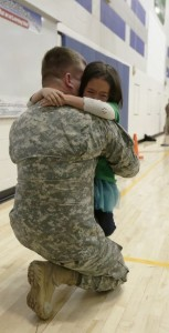 soldier with young daughter